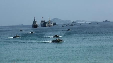 努力建设革命化、正规化、精锐化、现代化的海军军种,坚定维护祖国海洋岛屿主权