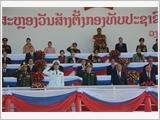 Đại tướng Ngô Xuân Lịch dự Lễ kỷ niệm 70 năm Ngày thành lập Quân đội nhân dân Lào tại Vientiane