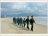 岘港市军事力量加强与公安配合实现国防安全任务