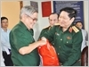 Đại tướng Ngô Xuân Lịch, Ủy viên Bộ Chính trị, Phó Bí thư Quân ủy Trung ương, Bộ trưởng Bộ Quốc phòng thăm và tặng quà gia đình chính sách ở thị xã Long Khánh, tỉnh Đồng Nai