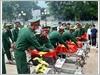 Thực hiện các nghi thức chuẩn bị an táng hài cốt Liệt sĩ Quân tình nguyện và Chuyên gia Việt Nam hy sinh tại Lào về Nghĩa trang Liệt sĩ Tông Khao (tỉnh Điện Biên)